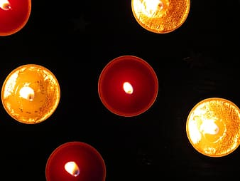Six assorted-color of lighted candles