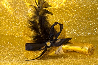 Closeup photo of liquor bottle with feather decor