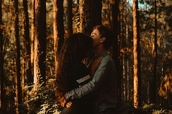 Man and woman hugging in the forest