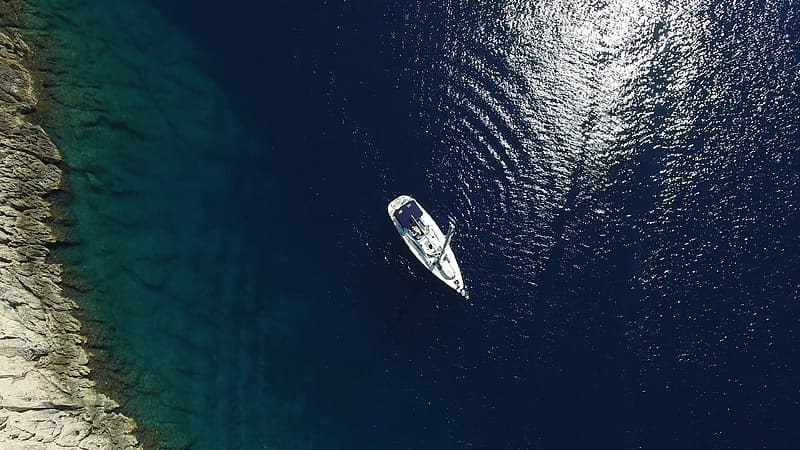 Boat on body of water during daytime
