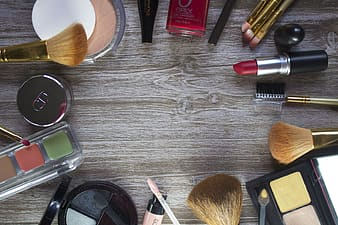 Women's assorted cosmetic products forming circle