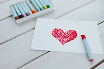 Heart drawing on white paper