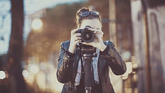 Woman holding camera taking picture