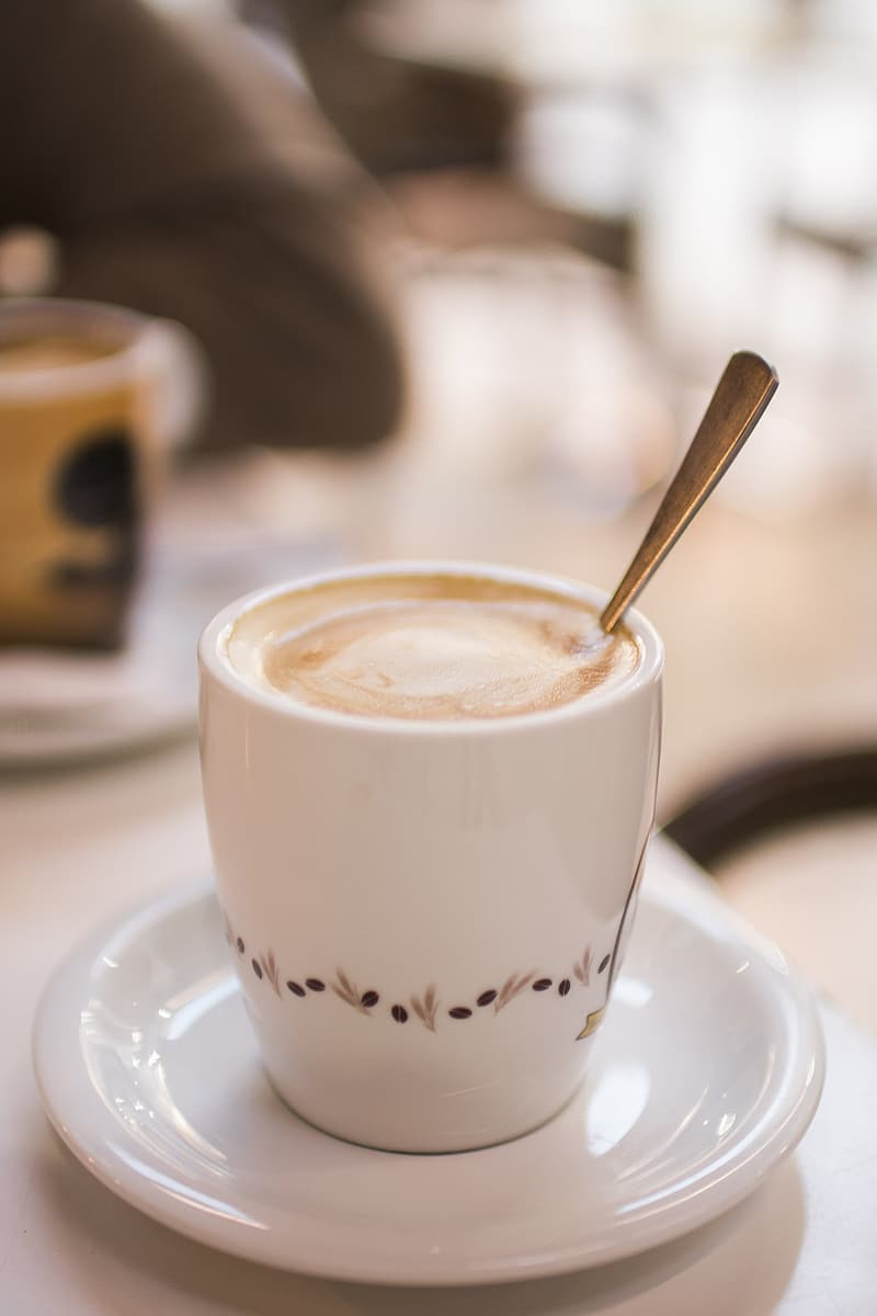 White cup with latte