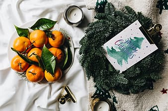Still life of mandarin oranges with leaves