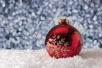 Red bauble on white surface