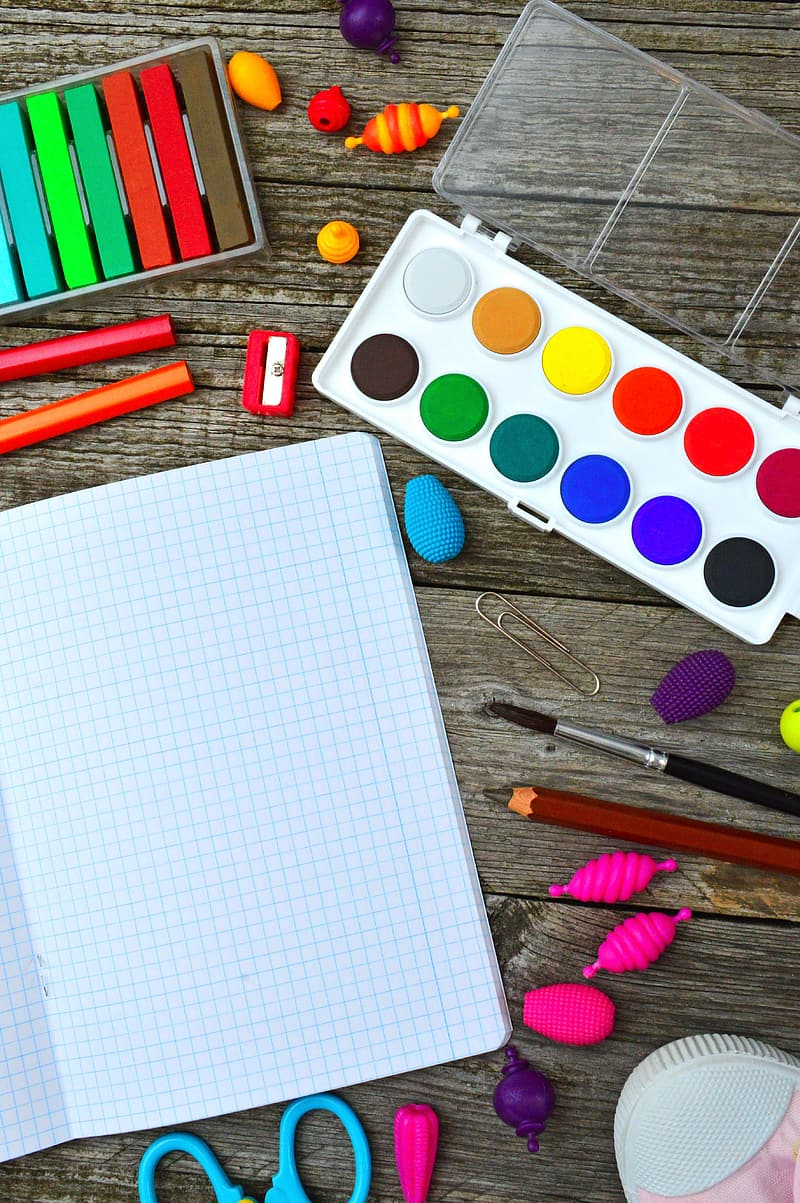 White paper with multi colored polka dot print