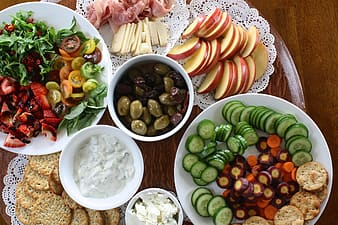 Sliced assorted fruits and vegetables on the table
