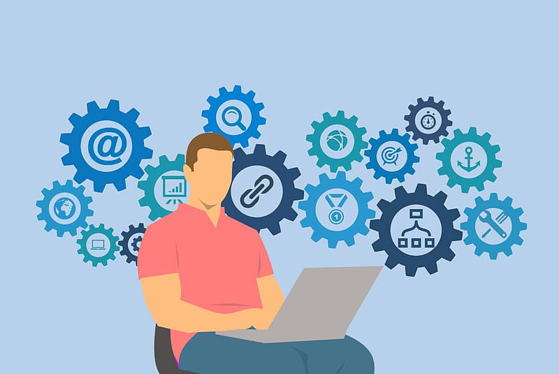 Illustration of man on laptop computer with social media network gear grinding away
