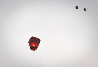 Candle lanterns floating under clear sky