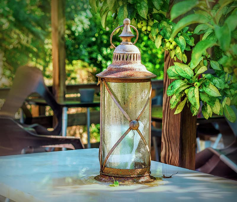 Clear glass candle lantern on white table