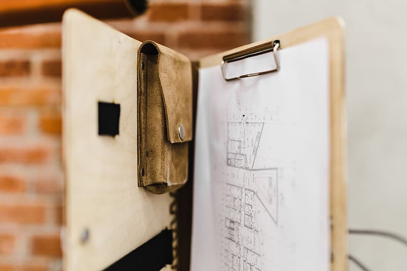 Architecture plans in an elegant leather bag