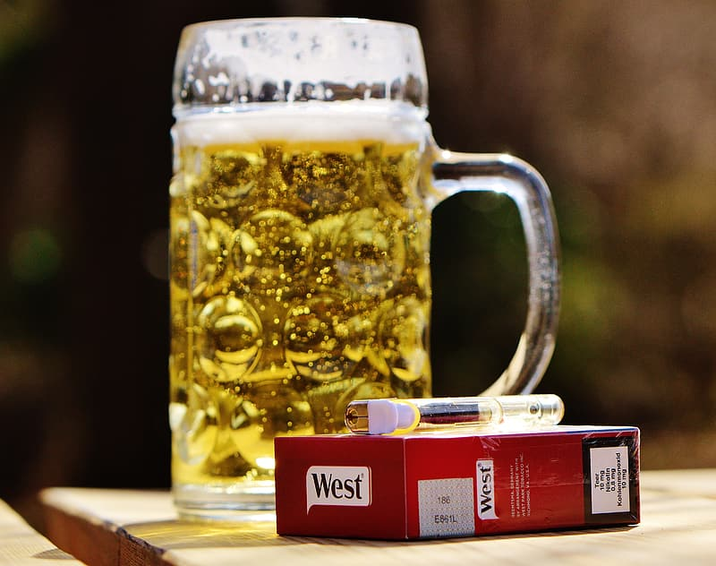 Clear glass beer mug with beer on brown wooden table