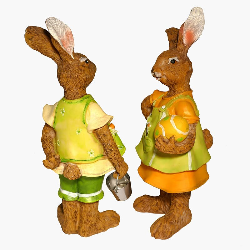 Brown rabbit holding green vegetable figurine