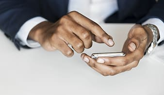 Person using smartphone with wearing suit