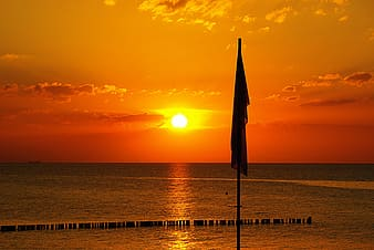 Silhouette of flag during golden hour