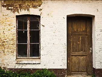 Photograph of house with closed door and window