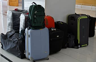 Assorted-color travel luggage