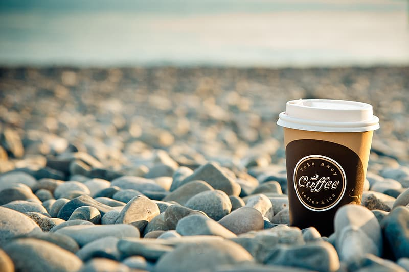 Coffee cup on stones