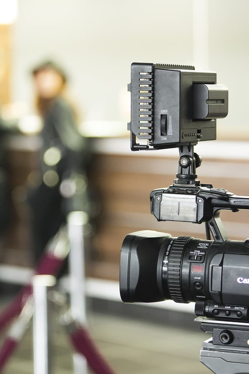 Tilt-shift lens photography of black Canon camera on a stand