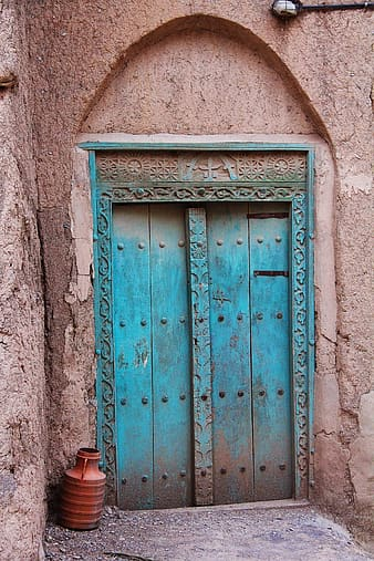 Blue wooden door on gray concrete wall
