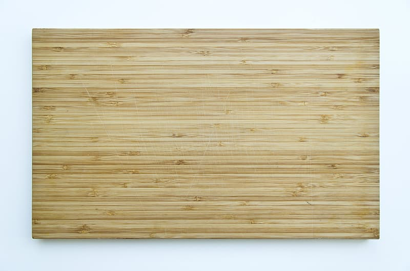 Brown wooden plank on white surface