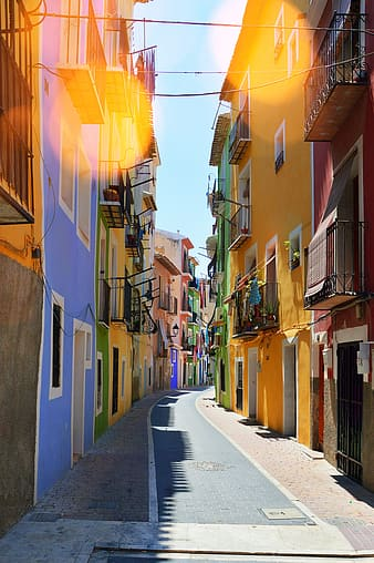 Narrow road between colorful houses