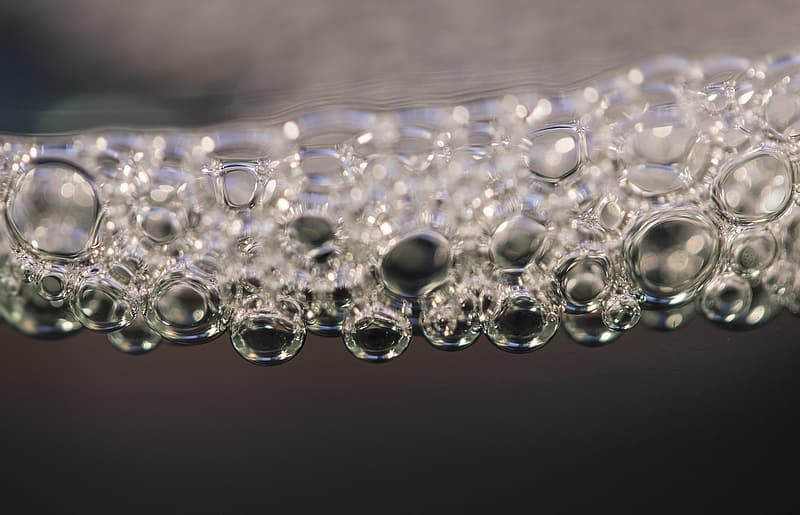 Water droplets on glass in close up photography