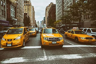 Taxis wait on the busy streets of Manhattan in New York City