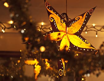 Lighter black and yellow star ornament