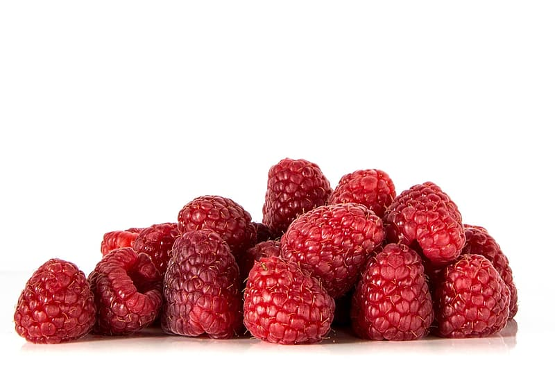 Raspberries on white surface