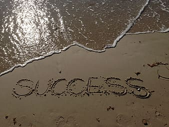 Gray sand with SUCCESS engraved