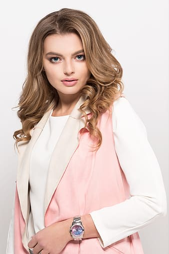 Woman in pink blazer and white dress shirt