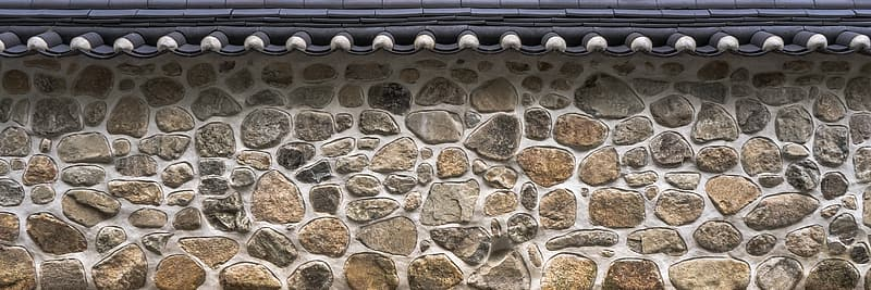 Brown and black stone wall