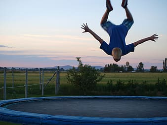 Boy about to land on trampoline