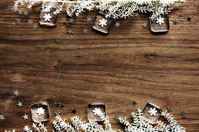 Six snowflake paperweights on brown wooden tabletop