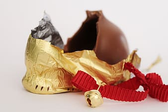 Chocolate beside red and gold string bell