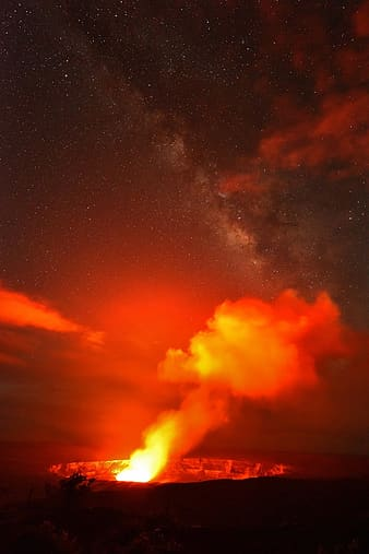 Fire and smoke under starry sky during night time