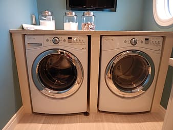 Two white front-load washer and dryer set'
