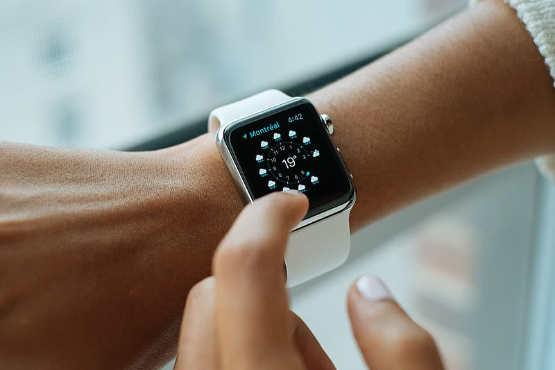 Person wearing silver smartwatch