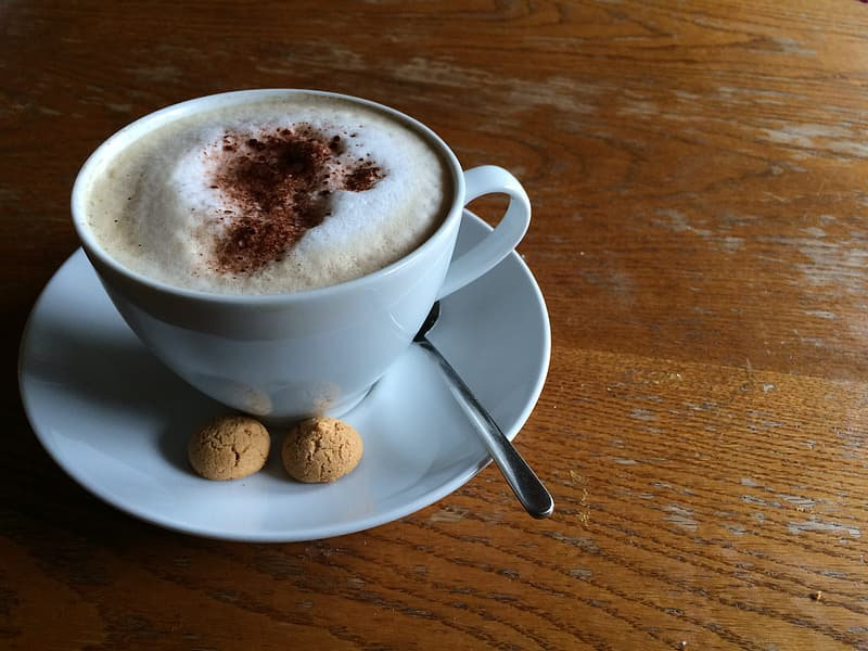 Cup of cappuccino on saucer