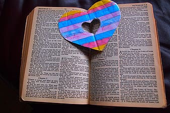 Heart greeting card on book