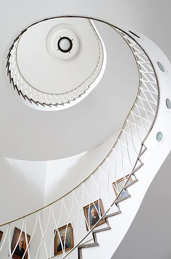 White spiral staircase with brown metal railings