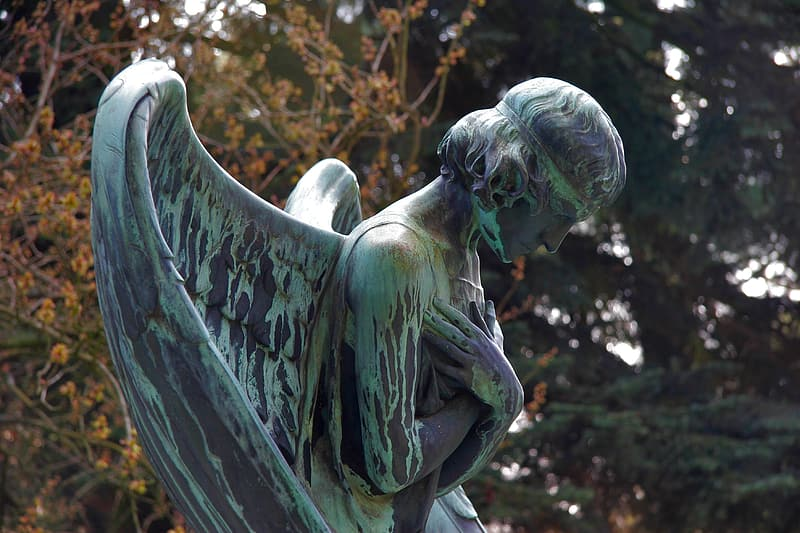 Teal and gray angel statue