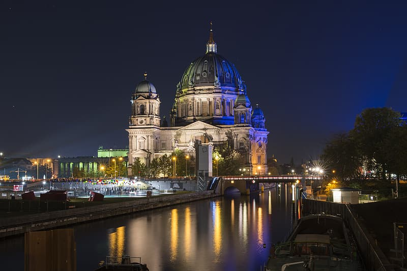 White and blue dome building near body of water during night time