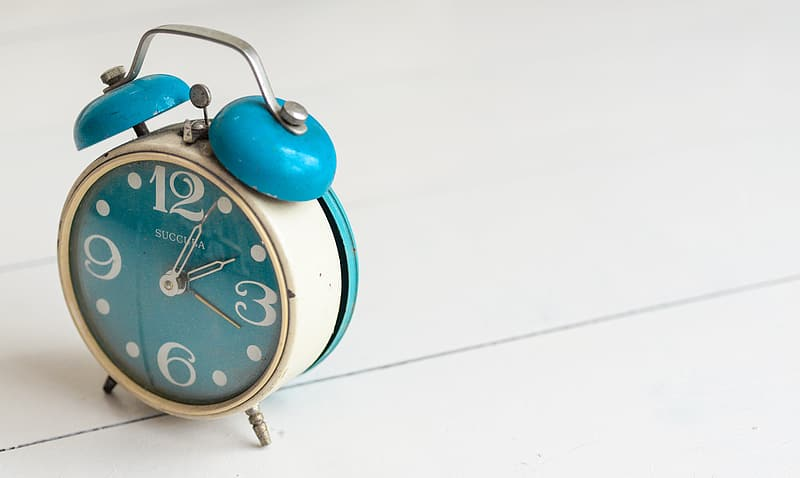 White and teal bell alarm clock