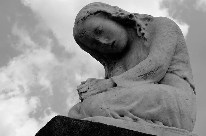 Low angle photography of gray woman statue