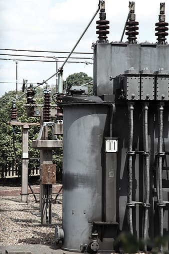Gray steel electricity transformer during daytime
