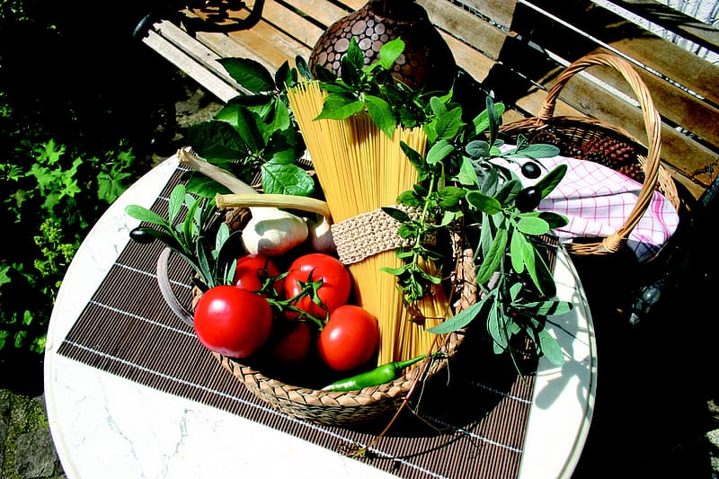 Tomato and pasta noodles in basket