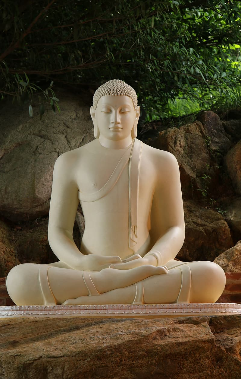 White statue on brown rock